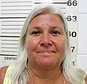 FILE - This file photo provided by the South Padre Island Police Department shows Lois Riess, of Blooming Prairie, Minn., who was arrested by federal deputy marshals April 19, 2018, at a restaurant in South Padre Island, Texas in connection with the killings of two people in separate states, including her husband. Riess will attend an extradition hearing Monday, April 23, 2018, to send her to Florida. (South Padre Island Police Department via AP, File)