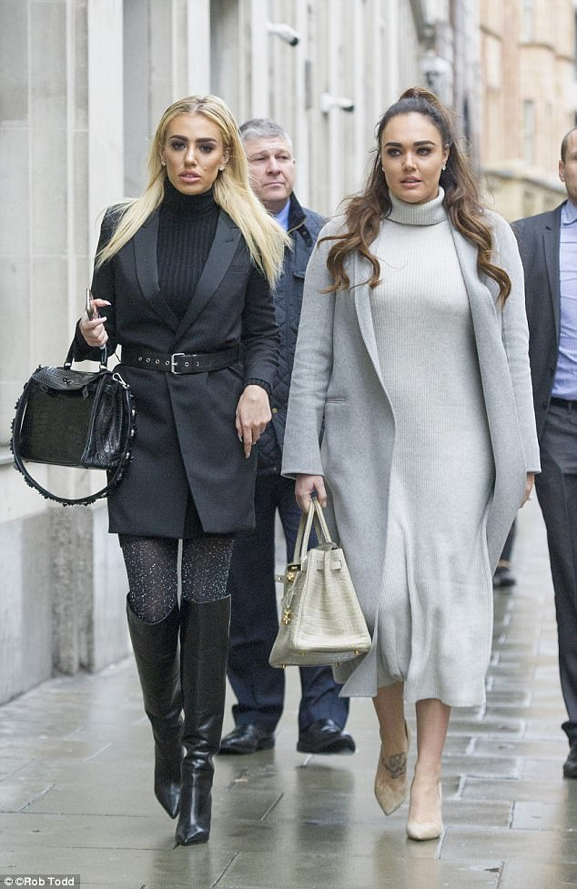 Petra Ecclestone (left) and her sister Tamara put on a united front when they arrived at the High Court on Wednesday morning