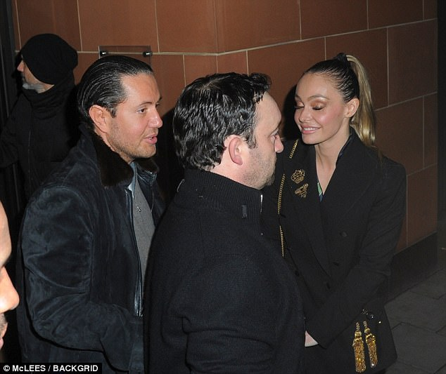 Stunt was wearing a dark jacket as he walked out of the restaurant with a blonde companion