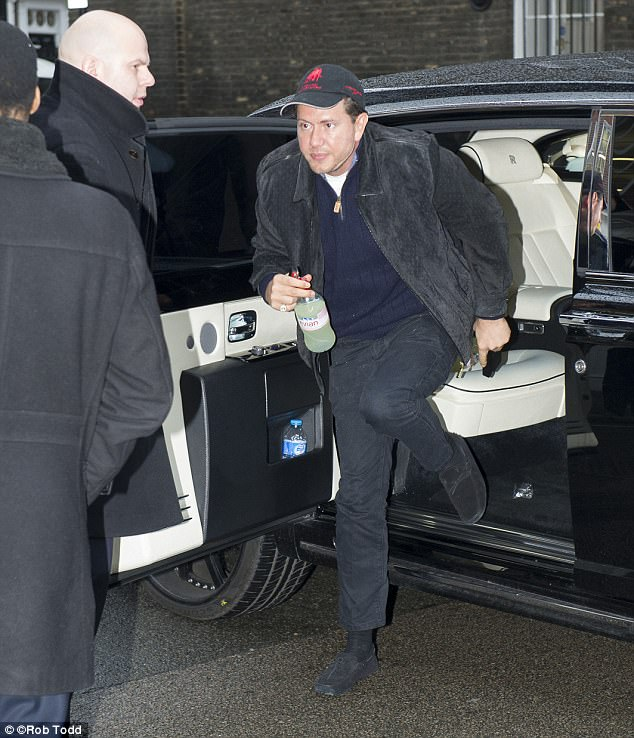 Mr Stunt is pictured here arriving at the High Court in London on Tuesday morning as their divorce battle continues