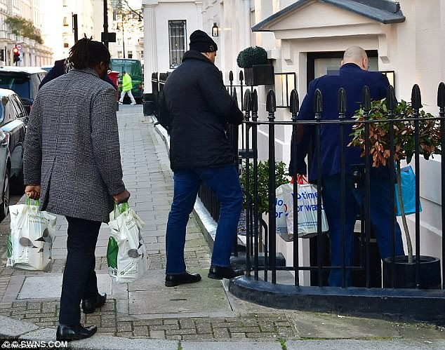 The billionaire's staff and bodyguards were spotted piling belongings into the expensive property in Belgravia in December
