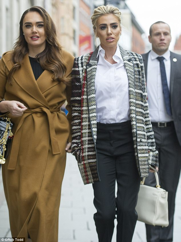 Petra and Tamara Ecclestone put on a chic display as they made their way into the High Court in London yesterday