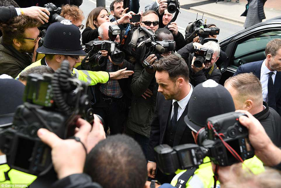 Seven uniformed police officers were at the door of the court to shield the star from cameras as he arrived this afternoon
