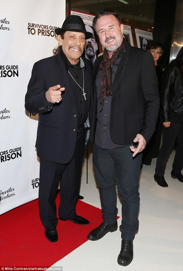 Old pals: The Scream actor also posed with Danny Trejo who wore a large silver cross and a snazzy black hat