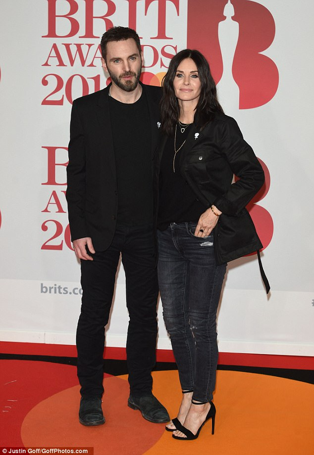 His ex: Meanwhile, his ex Cox was seen with her boyfriend of five years, Snow Patrol musician Johnny McDaid, at the Brit Awards in London on Wednesday