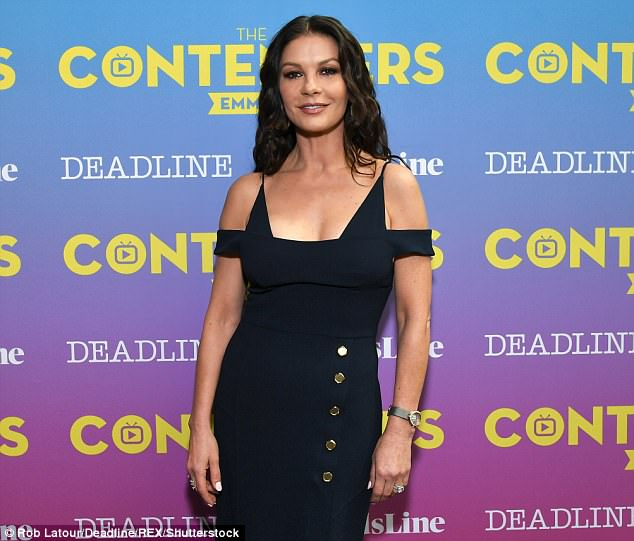 Stunning: The screen star nailed Hollywood glamour as she slipped her slender frame into a plunging navy midi dress