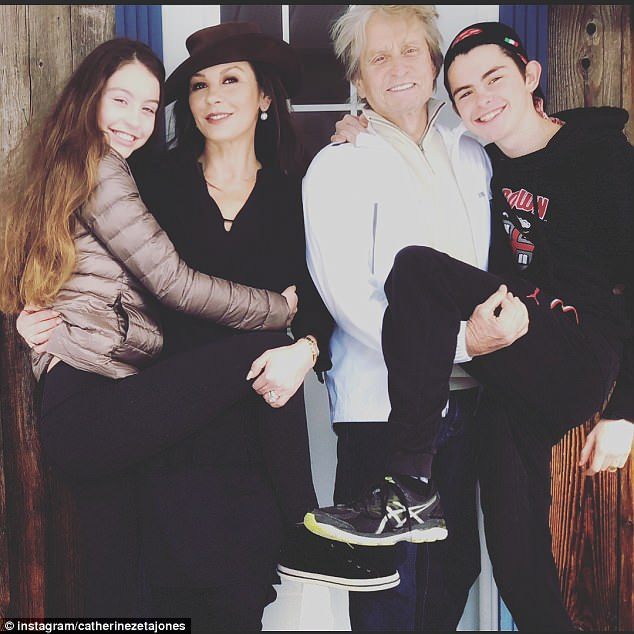 Family photo: Her latest updates come shortly after she shared a nostalgic shot featuring herself, husband Michael Douglas, 73, and their two children - Carys and Dylan