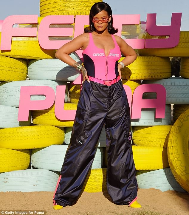 Outfit change: Earlier in the day, Rihanna opted for a bright pink swimsuit as she hosted her FentyxPuma party
