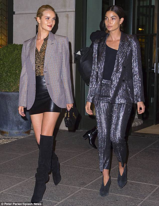 Chic:Rosie Huntington-Whiteley, 30, joined forces with fellow model mummy Lily Aldridge, 32, as they headed out on a girls' dinner date in New York City on Thursday