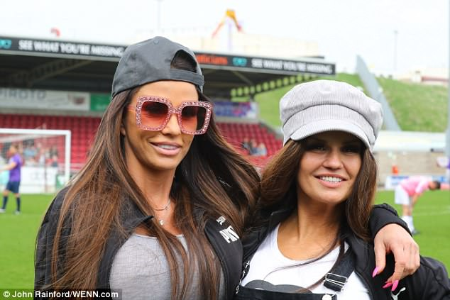 Pals again:TV pal Kerry Katona beamed as she posed with Katie at the football match in an on-trend grey baker boy hat and classic black dungarees