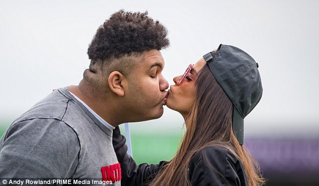 Pucker up: Katie Price, 39, displayed her close bond with eldest son Harvey, 15,  at theSellebrity Soccer charity match at the Sixfields Stadium in Northampton on Sunday