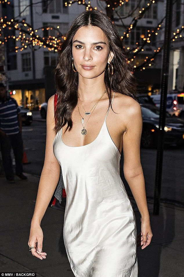 Nice: The 26-year-old model showed off her fantastic figure as she sauntered into the lower Manhattan hotspot wearing a silky white shift dress