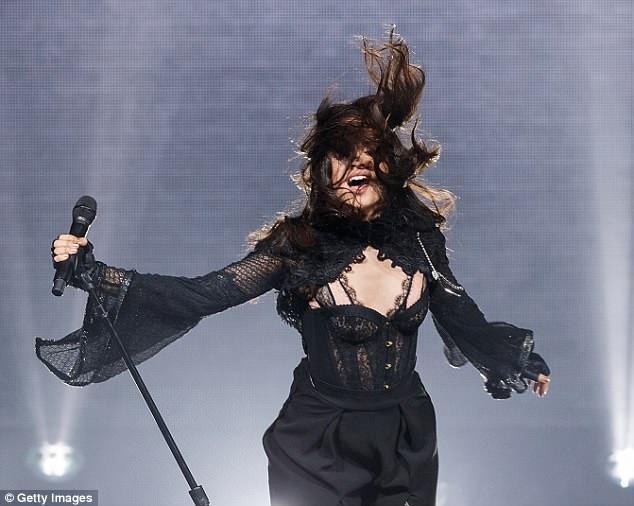 Dancing queen: Her chocolate brown hair was worn in loose waves and she kept a more natural approach to her makeup, sporting bold brows and nude lipstick