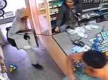 This is the moment knife-wielding robber Paul Christian Callaghan, 45, confronted shopkeeper Ramyamuki Ithlayanathan at Ernie's News inNorth Ormesby, Middlesbrough