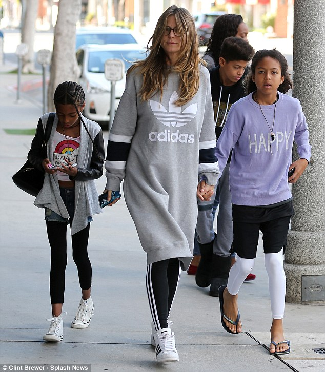 Fresh-faced: The 44-year-old supermodel relied on her specs appeal - as she went make-up free in eyeglasses alongside her children in Los Angeles, California