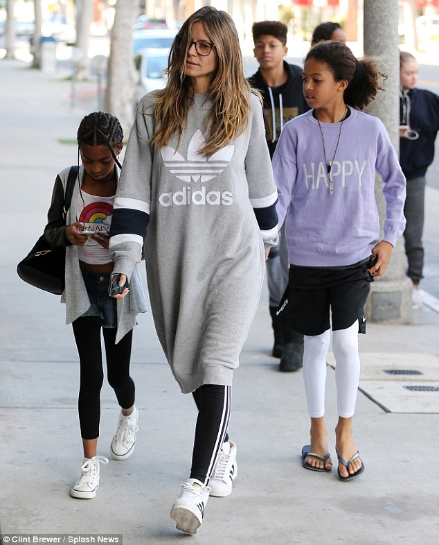 Specs appeal! Heidi Klum was taking it easy as she swamped her frame in a giant Adidas sweatshirt dress, on Saturday