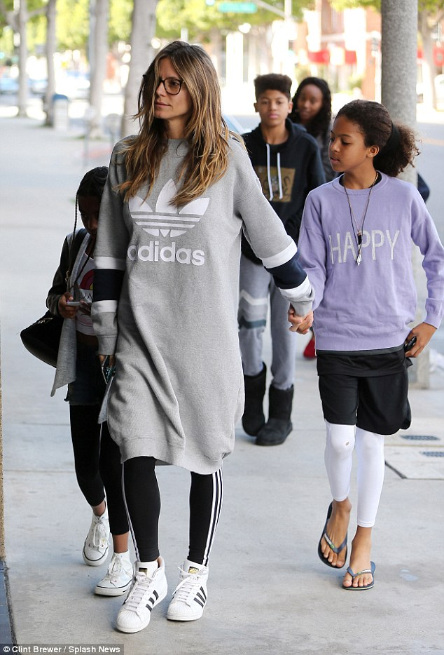 Family outing: The America's Got Talent judge had her children in tow - as she was hand in hand with daughter Lou, 8