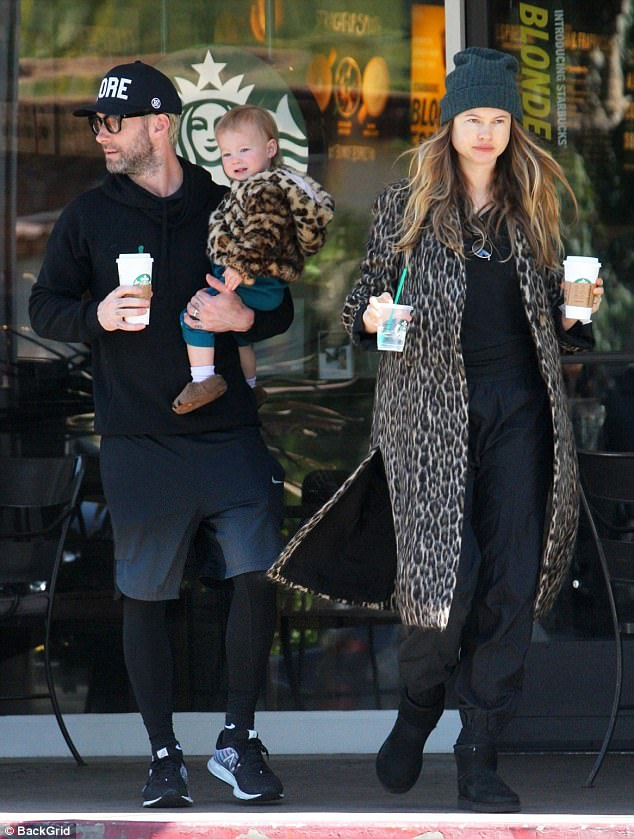 Out and about: Behati Prinsloo was pictured out on Wednesday with husband Adam Levine and their daughter Dusty Rose after welcoming their second child last week