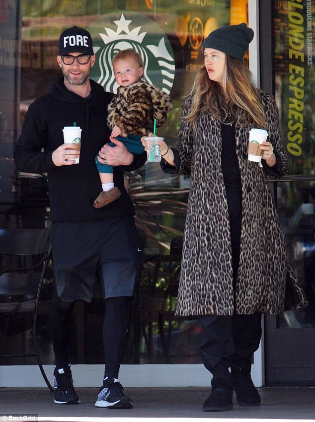 Coffee run: Keeping out the winter chill, the 28-year-old model looked snug in a fur leopard print coat as she was spotted leaving a Beverly Hills Starbucks