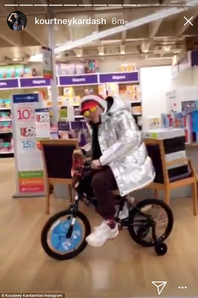 Safety first:The duo showed off their holiday spirit on her Instagram stories as they perused the aisles of the massive toy store before Harry jumped on a bicycle