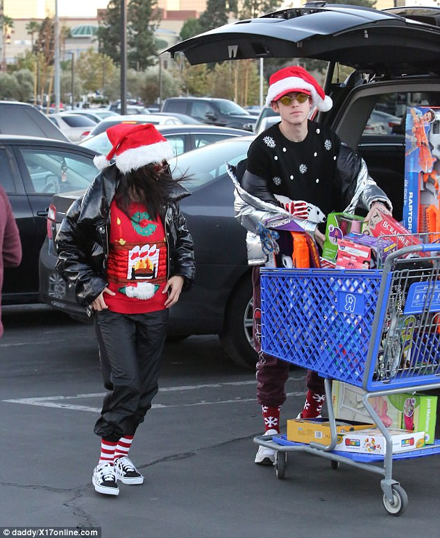 Shopper: Kourtney was in the giving spirit as she dressed in her holiday best for the fun afternoon with Kardashian family friend Harry Hudson.