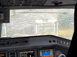 The picture shows the pilot sat at the controls in front of the shattered cockpit windscreen
