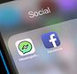 """FILE- In this Feb. 16, 2018, file photo, Facebook and Facebook's Messenger Kids app icons are displayed on an iPhone in New York. Facebook is adding a """"sleep"""" mode to its Messenger Kids service so parents can limit how much time children spend on it. (AP Photo/Richard Drew, File)"""