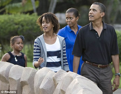 Important: Mrs Obama has  openly spoken about nursing her youngest daughter, Sasha (far left), and is especially pushing breastfeeding in the black community