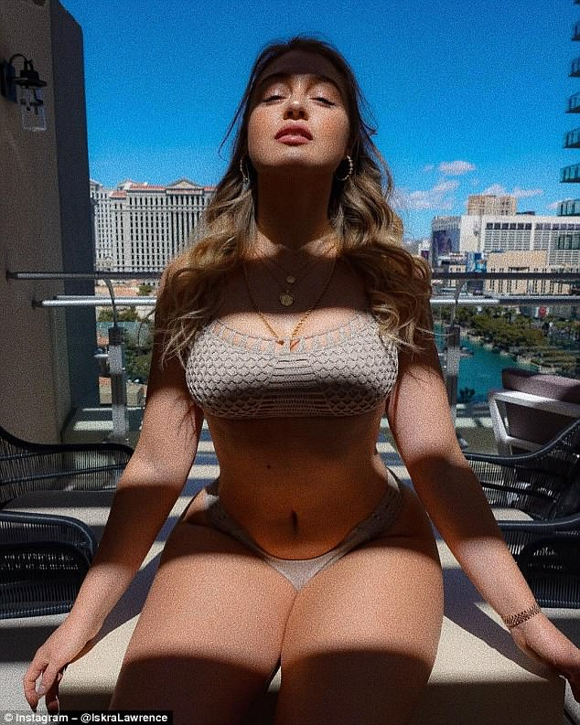 Busty: The bombshell sizzled in a mink crochet bikini, which highlighted her tiny waist, while posing against the Las Vegas skyline earlier this month
