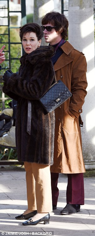 A-list: She added to the lavish movie-star feel with an opulent furry dark brown jacket, which was belted in the middle to show off her trim midriff