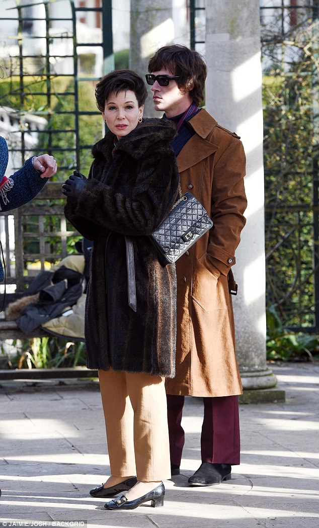Late icon: Renee Zellweger, 48, transformed into Judy Garland, as she filmed scenes with her co-star Finn Wittrock - who plays her fifth husband in the biopic Judy - in London on Thursday