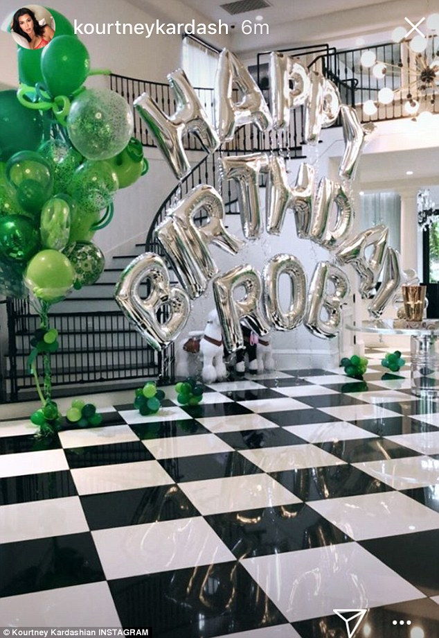 In the mood for green: Kourtney Kardashian shared this image of green balloons as she wished her brother a happy 31st birthday