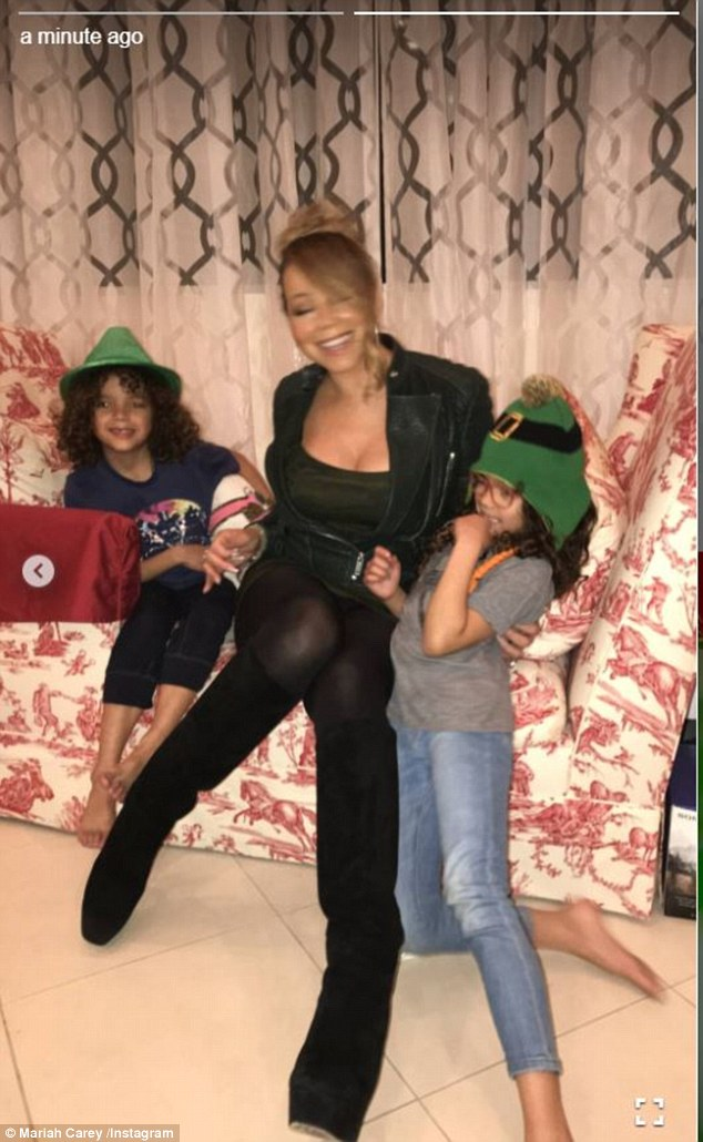 Family affair: Mariah had fun with her twins Moroccan and Monroe who wore festive green hats