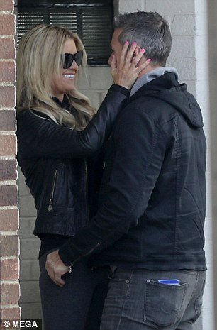Look of love: She playfully placed her hands on the sides of his head
