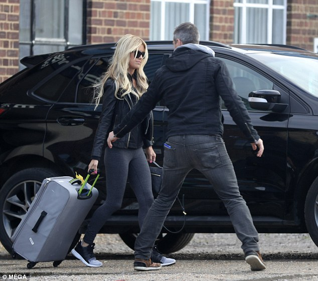 What a gent! Christina was rolling one of their luggages toward the car but Ant insisted that he put it in