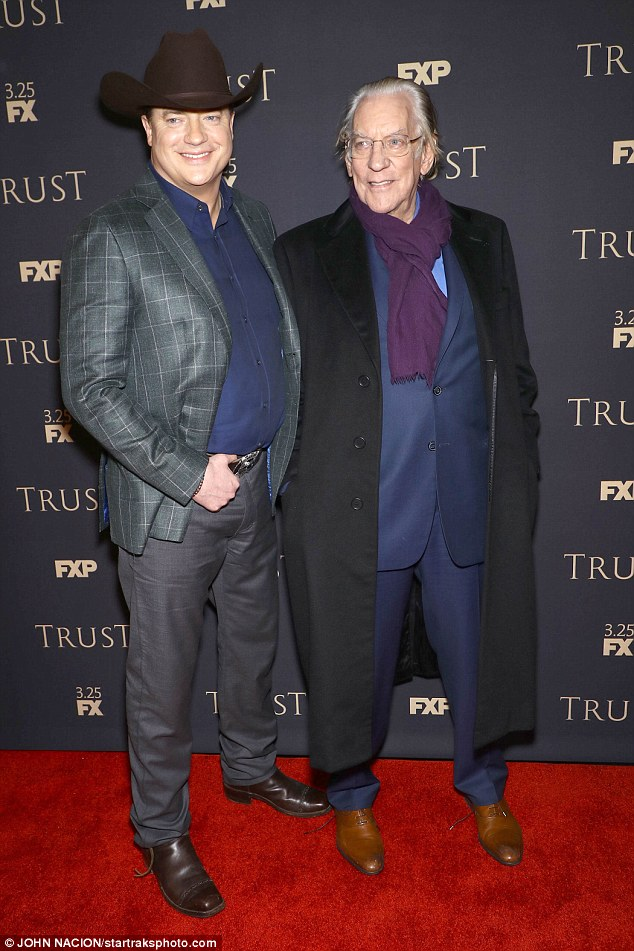 His new role: The actor in a cowboy hat as he poses with Donald Sutherland for the premiere of Trust in NYC earlier this month