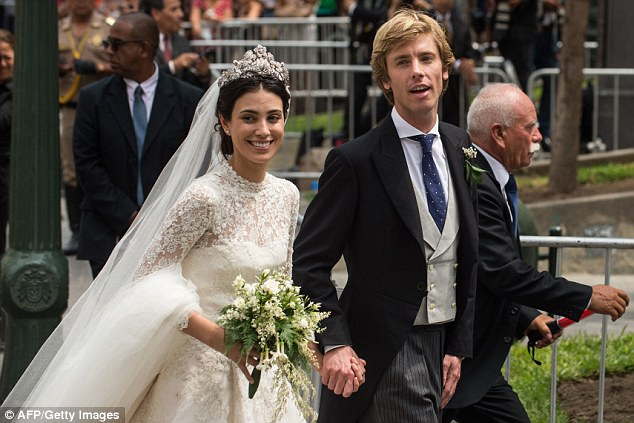 The happy couple: Peruvian Alessandra de Osma and her husband Prince Christian of Hanover can't help but smile as they arrive at their second wedding