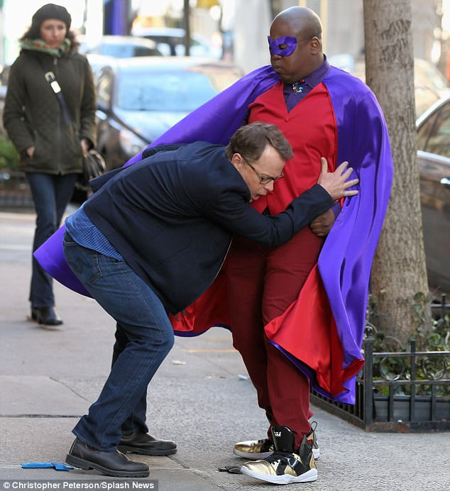 Under attack: Greg's character tried to tackle Titus Andromedon on the sidewalk