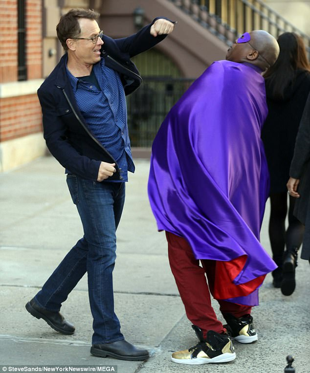 Street fight: Greg Kinnear and Tituss Burgess filmed a fight on Wednesday in New York City for the upcoming season of the Netflix sitcom Unbreakable Kimmy Schmidt