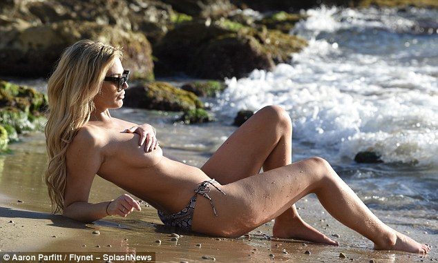 Looking good: The dumped Love Islander shielded her eyes from the sweltering sunshine when she chilled out on the beach
