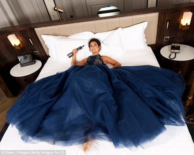 Stunning: The Hear'Say star oozed glamour in the striking ensemble, as she playfully showed off the voluminous skirt in a number of sultry shots