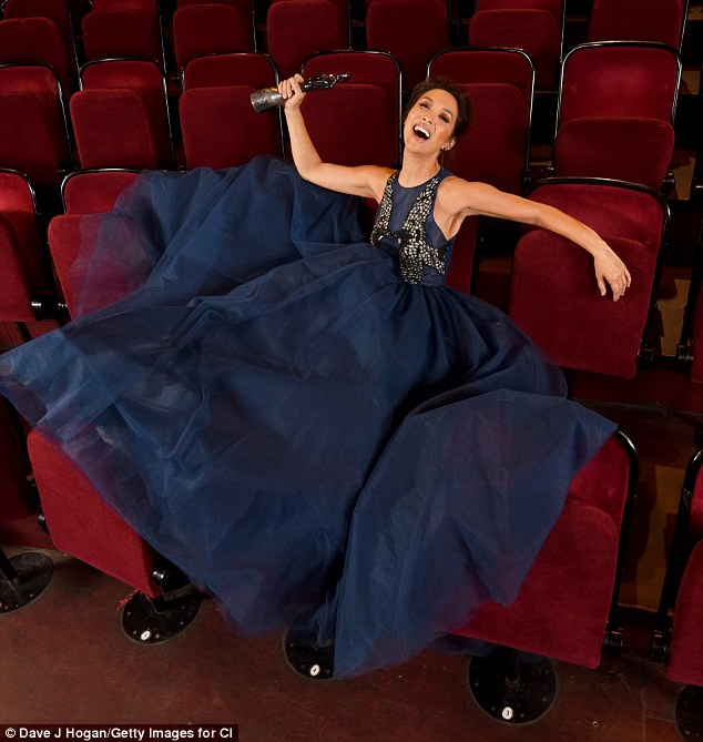 Excited: In one snap, the former singer reclined on the plush seats at the Royal Albert Hall clutching a brit