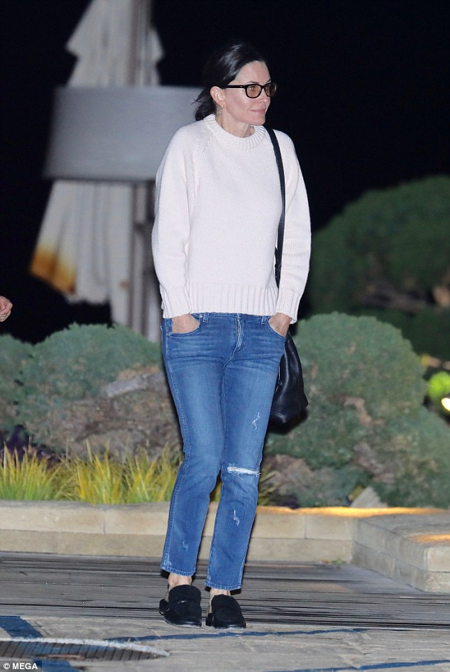 Casual Chic: Cox wore a cream sweater, distressed denim and loafers for her romantic night with McDaid