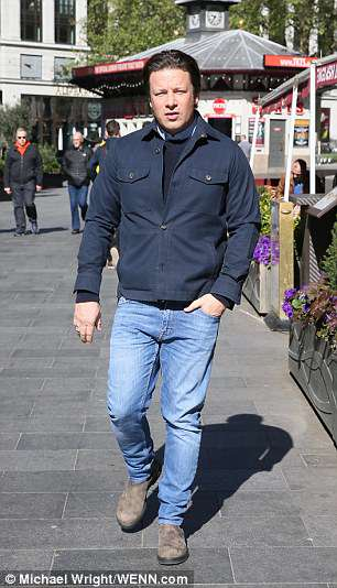Jamie Oliver, looking lean as he was photographerd this mourning ahead of his select committee appeaeranc e