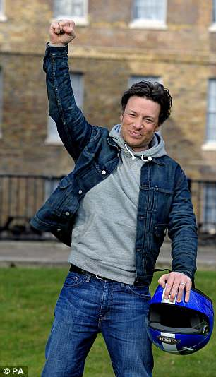 Celebrity chef Jamie Oliver on College Green in Westminster, London, after he welcomed the announcement of a tax on sugary drinks, telling fellow campaigners: 'We did it!'