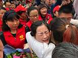 MotherWang Yonghui cries as she hugs her long-lost daughter Wang Xue. The daughter was kidnappedon her way to school when she was only seven years old in 1997