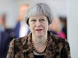 Theresa May (pictured in Ulverston yesterday) today told her Cabinet today the House of Lords must not try to tie her hands in Brexit talks as she vowed a 'robust' response to a crushing defeat