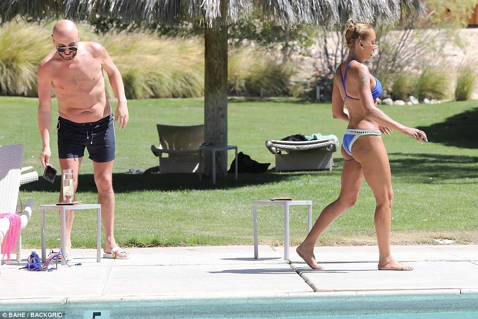 Calm: Mel was in full relaxation mode as she walked along the pool with Gary
