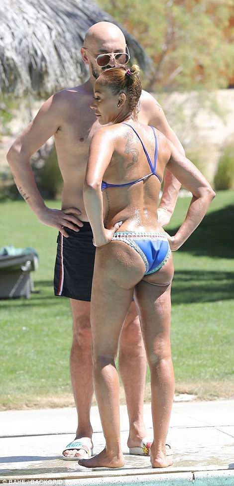 Peachy: The star flaunted her perky derriere and slender waistline in her skimpy ensemble