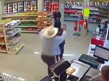 This is the heart-stopping moment a have-a-go hero disarmed a gun wielding robber and then tackled him to the ground as he tried to escape from a convenience store in Mexico
